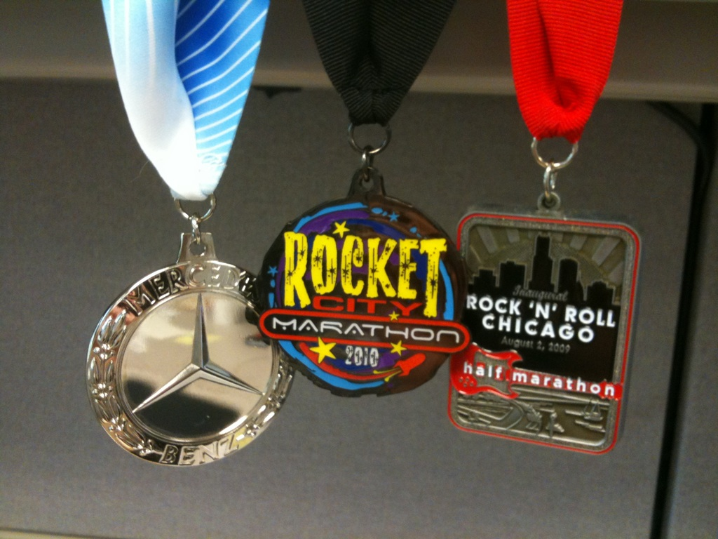All of my medals from running